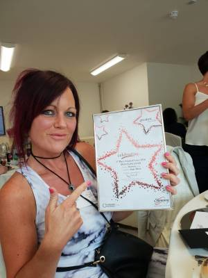 Angie and certificate